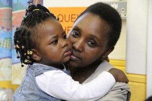 photo - A mother and daughter at the New North London Synagogue drop-in centre for asylum seekers.
