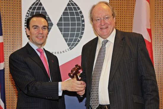 photo - Canada's Dr. Mario Silva hands the gavel over to the United Kingdom's Sir Andrew Burns