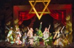 photo - The cast of Spamalot, with Josh Epstein at centre, on one knee
