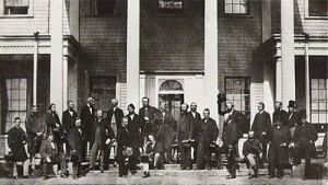 photo - Delegates from the legislatures of Canada, gathering on the steps of Prince Edward Island's Government House for the Charlottetown Conference in 1864