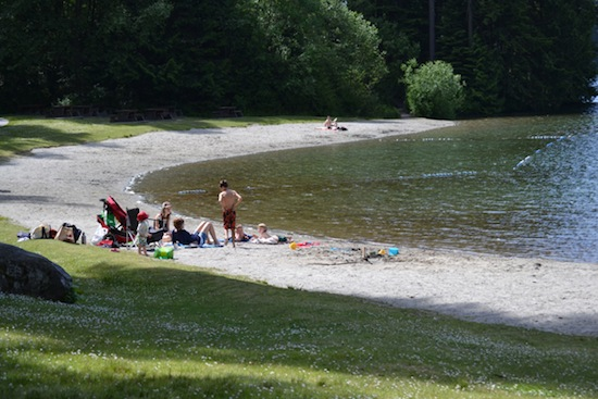 photo - The options are numerous at White Pine Beach: you can rest and absorb the serenity, take a swim or or build a sandcastle