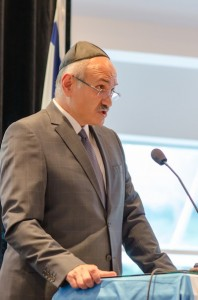 photo - Farid Rohani, a businessman, social activist and a board member of the Laurier Institution, speaks to those gathered at Temple Sholom