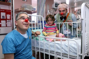 photo - David Shilman (Dream Doctors) playing with his patient, and the nurse at Rambam Medical Centre, Haifa