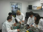 photo - A group of Herzliya Science Centre students working on Duchifat 1 in the clean room with Dr. Ana Heller