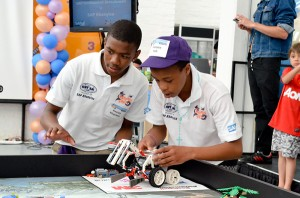 "photos - ORT SA Cape director Dr. Lydia Abel has observed, ""The kids are instantly enthralled by the LEGO robotics and they soon discover that the only way they can build them is by reading the how-to program and, suddenly, it's all they want to do."""