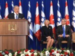 photo - Prime Minister Binyamin Netanyahu at Ben-Gurion Airport with Prime Minister Stephen Harper and wife Laureen