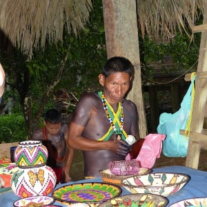 photo - Members of the Emberá tribe present their wares for sale, including their brightly colored woven baskets