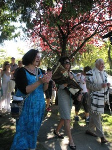 photo - Baalat Tefillah Debby Fenson and congregants escort the Torah to its new home