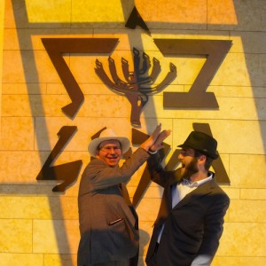 photo - Rabbi Jonathan Infeld and Cantor Lawrence Szenes-Strauss celebrate outside the synagogue