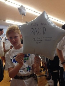 "photo - Zevi Kline with a ""You've been RAC'd!"" balloon"
