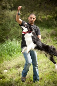 photo - Ofer Biton with a therapy dog. The dog is the tool for the therapist, facilitating the initial connection with the client