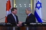 photo - Canada's Foreign Minister John Baird, left, meets with Israeli Prime Minister Binyamin Netanyahu earlier this week