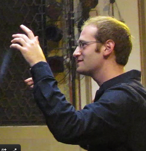 photo - YMCA Jerusalem Youth Chorus founder and conductor Micah Hendler