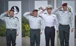 photo - At a ceremony in Tel Aviv, Gadi Eizenkot, second from left, succeeds Benny Gantz, far right, as IDF chief of staff