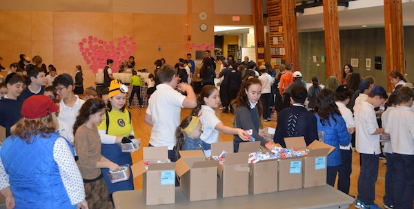 photo - Some 90 volunteers put together 1,300 mishloach manot packages
