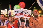 "photo - At a rally in Rabin Square in Tel Aviv on March 7, calling for Prime Minister Binyamin Netanyahu to be replaced in the upcoming elections, protesters held signs saying ""Change Now"""