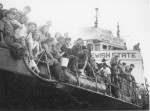 photo - A boat of new immigrants arrives in pre-state Israel on Oct. 2, 1947