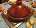photo - A tagine is a North African, slow-cooked savory stew, named after the earthenware clay pot in which it is cooked