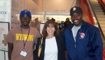 photo - Ruth Hoffman with baseball player Arthur Lusala, left, who today studies developmental economics at university, and coach George Mukhobe