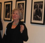 photo - Jennifer Levine, Fred Schiffer's daughter, speaks at the opening of the exhibit of her father's work