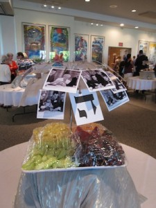 photo - At each table, there were photos of those who inscribed a letter in the Torah