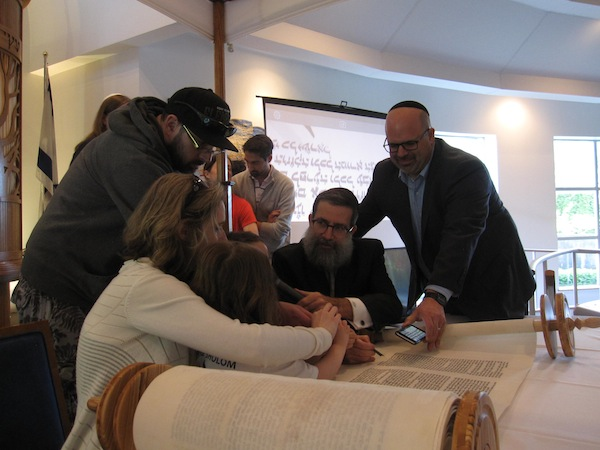 Torah writing unifies