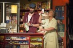 photo - Luc Roderique as Usnavi and Sharon Crandall as Abuela Claudia in Arts Club's In the Heights