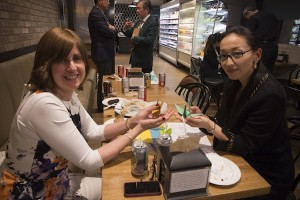 photo - Ruth Erlichman, left, with Ai Nakano, make origami cranes to be sold at another fundraiser
