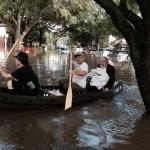 photo - Daniel Ogorek and Morgan Davis rescue Rabbi Emeritus Joseph Radinsky in a canoe.