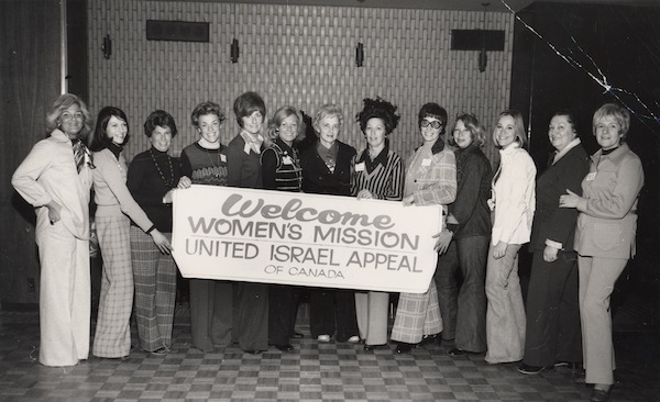 "photo - Women holding the banner ""Welcome, Women's Mission, United Israel Appeal of Canada,"" Vancouver, March 26, 1975"