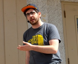 photo - Zach Fleisher in front of what used to be the building housing the city's Hebrew Sick Benefit Association