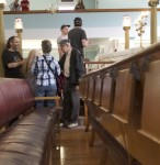 photo - Walk participants explore the Ashkenazi synagogue, the oldest in Winnipeg, on a tour led and organized by Zach Fleisher, seen below in front of what used to be the building housing the city's Hebrew Sick Benefit Association. (photo from Zach Fleisher)
