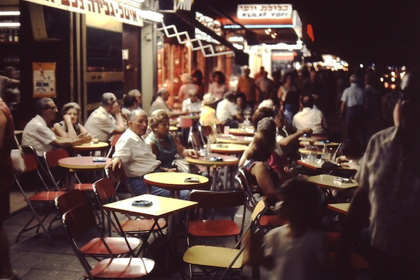 "photo - With café culture yet to be established, Dizengoff Street was one of the only places to go and, noting the average age of the clientele in this photo, the ""city that never sleeps"" did not apply to 1970s Tel Aviv"