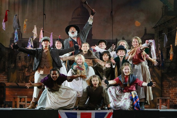 photo - Stephen Aberle as Fagin, Carly Ronning as Oliver (centre, on floor) and the young cast of Oliver!