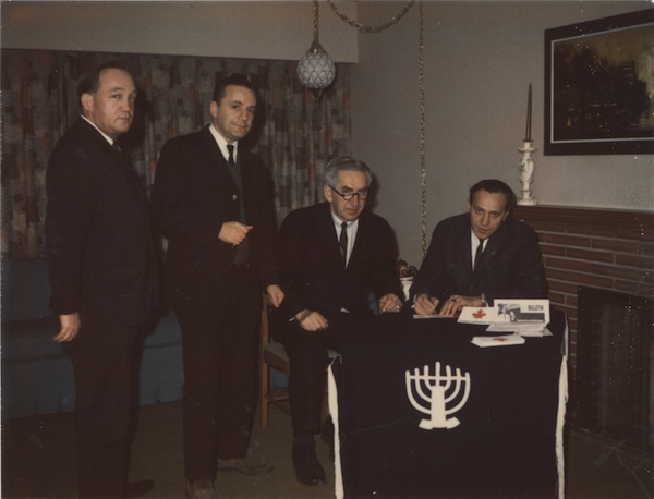 photo - Men at a B'nai B'rith event in someone's home, circa 1980. The four men (including Sam Lemer on the left) are preparing to sign a document