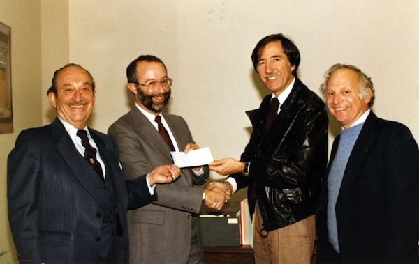 photo - Presentation of a cheque, B'nai B'rith, 1985. The four men include Sheldon Cole (second from left)B