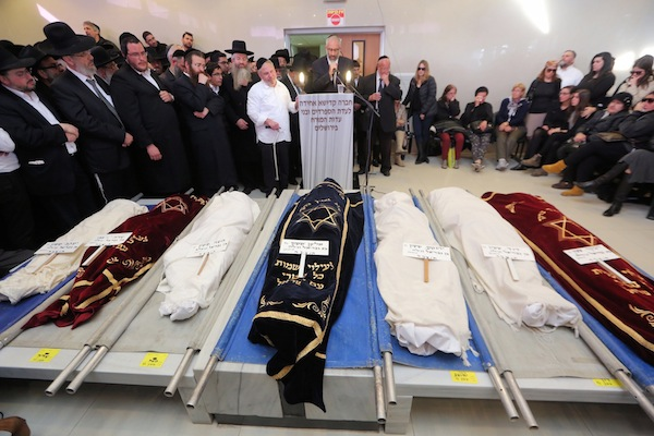 photo - On March 22, Gabriel Sassoon from New York eulogizes in Jerusalem his seven children who were killed in a house fire the previous Shabbat in Brooklyn.