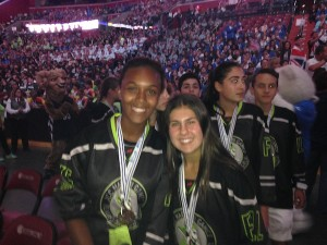 photo - Jada Wilson, left, and Sydney Cristall at the opening ceremonies of the games in Fort Lauderdale, Aug 7