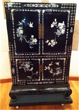 photo - Kehillat Beijing has transformed a Chinese antique piece into a small ark. There are Magen Davids on its doors