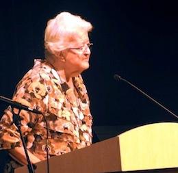 photo - Anna Yanovsky, the cartoonist's widow, speaks at the exhibit opening
