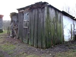 "photo - Some survivors are living in huts – ""no running water, no heat, broken windows."""