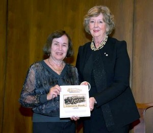 photo - Weston Girl Estelle Sures, left, presents a memory book of the Weston Girls tour to Manitoba Lieutenant Governor Janice Filmon