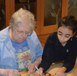 photo - Grade 6 and 7 girls of Vancouver Hebrew Academy joined Louis Brier Home and Hospital residents in making decorations for the home's sukkah