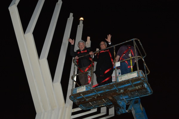 photo - Gary Averbach, left, and Richmond Mayor Malcolm Brodie light the menorah in Richmond