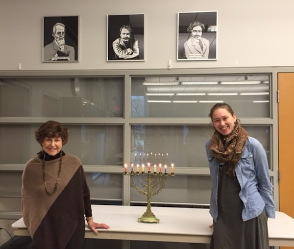 photo - Flora Field, left, and Emily Glass, students learning Yiddish with Haya Newman at the Peretz Centre for Secular Jewish Culture, take time out for Chanukah
