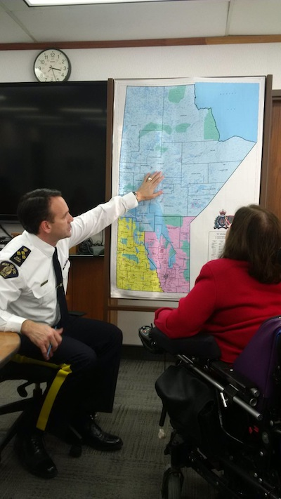 photo - Judith Heumann meets with Manitoba's Royal Canadian Mounted Police Chief Kevin Brosseau to discuss issues around persons with disabilities and the challenges they face in traveling