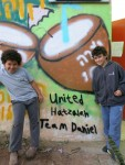 photo - United Hatzalah of Israel and Artists 4 Israel distributed art therapy kits to families in southern Israel and held a program that included visits by graffiti artists who worked with teens to paint neighborhood bomb shelters