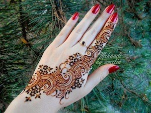 photo - An Islamic bride's hand is decorated as part of the henna pre-wedding ritual