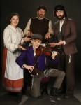 photo - Jewish community members in Royal City Musical Theatre's production of Fiddler on the Roof, left to right: Erin Palm, Warren Kimmel and Zach Wolfman, with Michael Wilkinson in front. The show runs April 7-23 at Massey Theatre