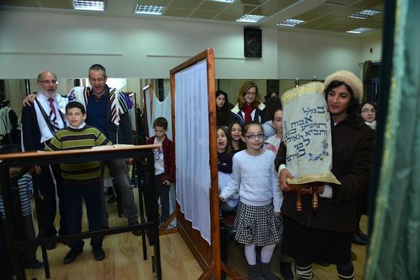 photo - Women at Zemer Hazayit return the Torah scroll to the ark